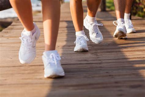 Sneakers Walking on Boardwalk