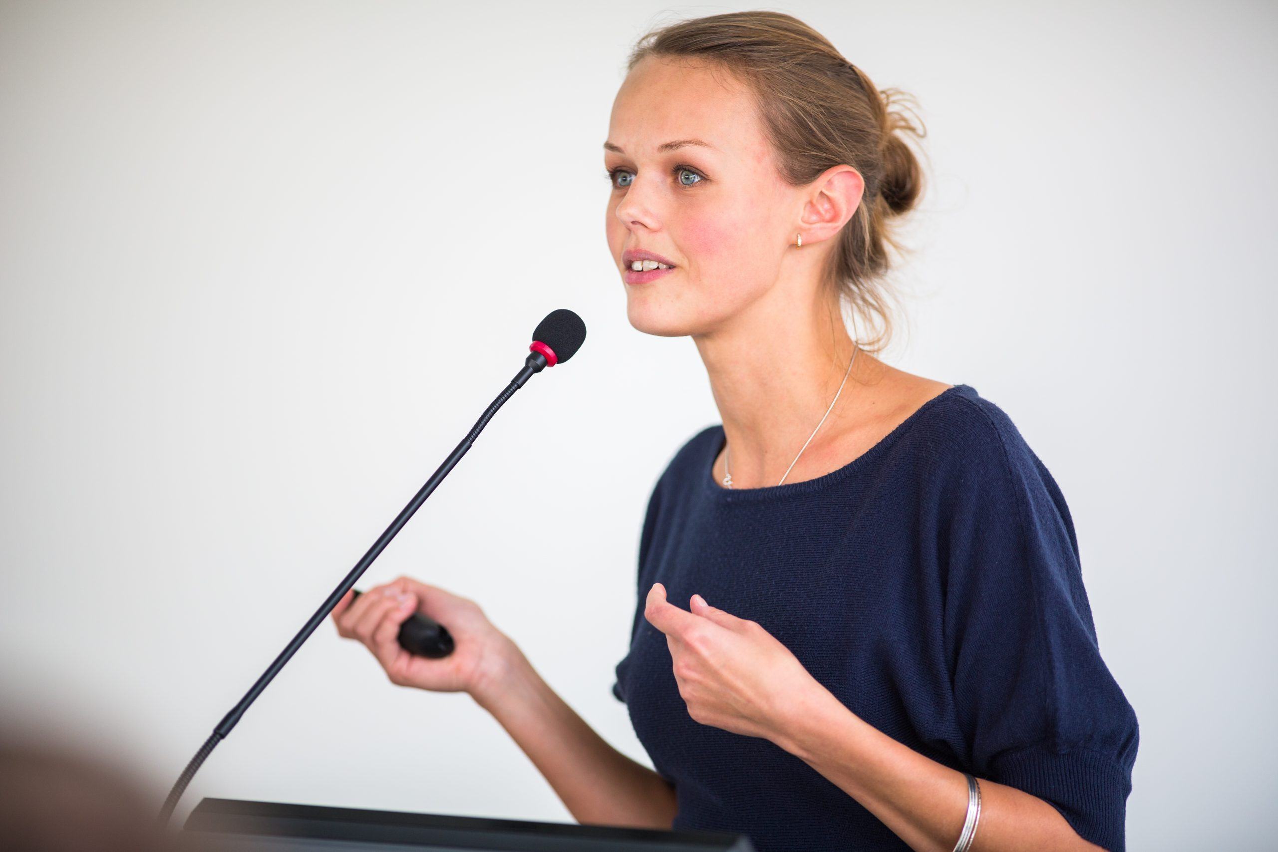 Business Woman Speaking at Conference