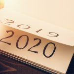Notepad or calendar with pages and text 2020 and 2019 in sunlight. New year, new beginnings and change concept